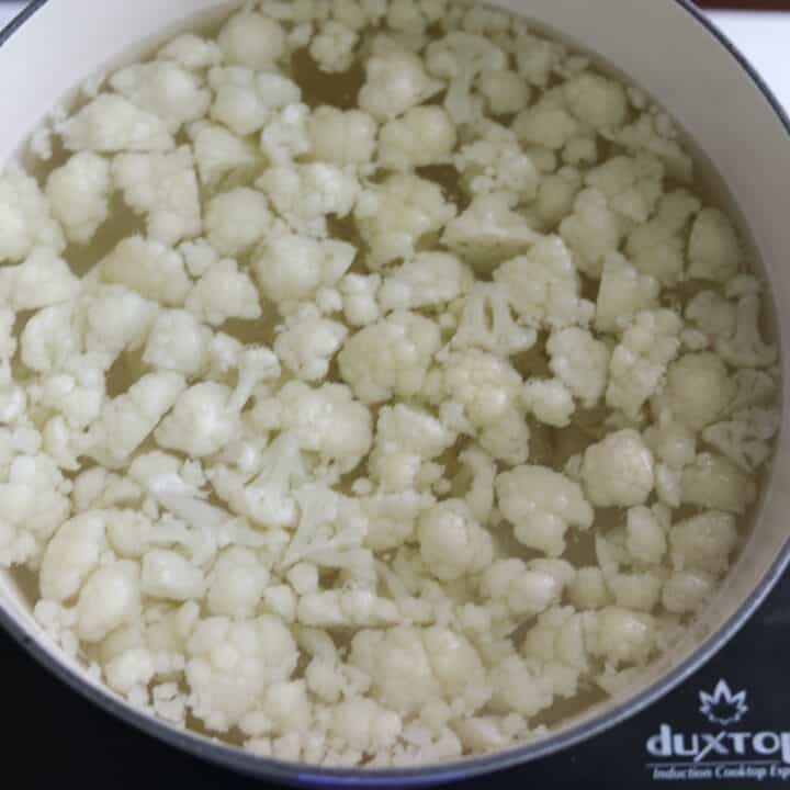pot of parboiled cauliflower for making tasty cauliflower mac and cheese